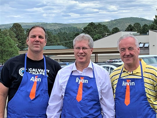 Dr. Ryan Carstens, center, president of the Ruidoso campus, served guests at the chill and grill with Albertson's manager Kevin Stepp and Calvary Chapel Pastor Alan Stoddard.