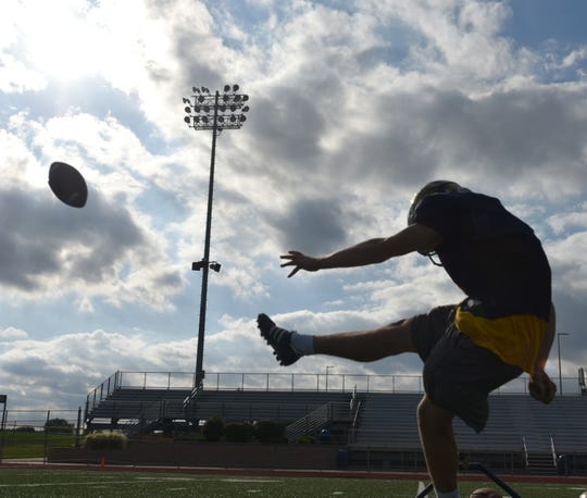 South Lyon High kicker William Stoyanovich practices on Sept. 25.