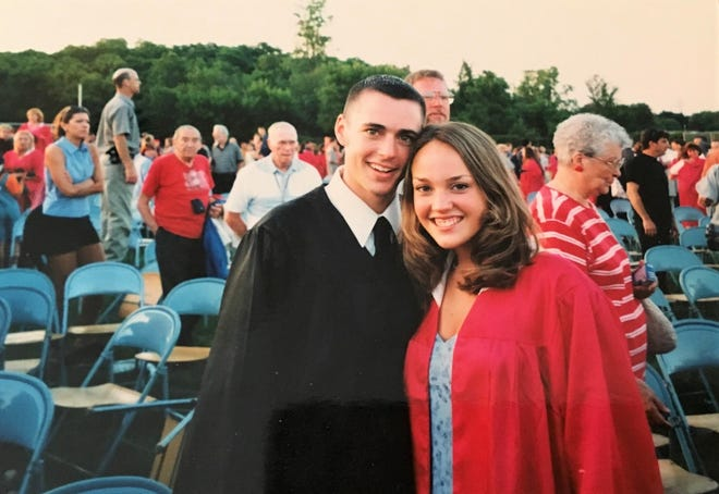 Paul and Kelly Mercier on their high school graduation day in 2000.