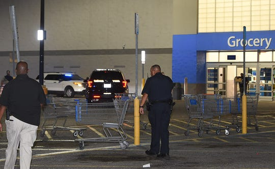 Police from the Opelousas Police Department search for clues following someone shooting about 15 rounds from an AR15 rifle into the back of the Opelousas Wal Mart around 9 p.m. Tuesday.