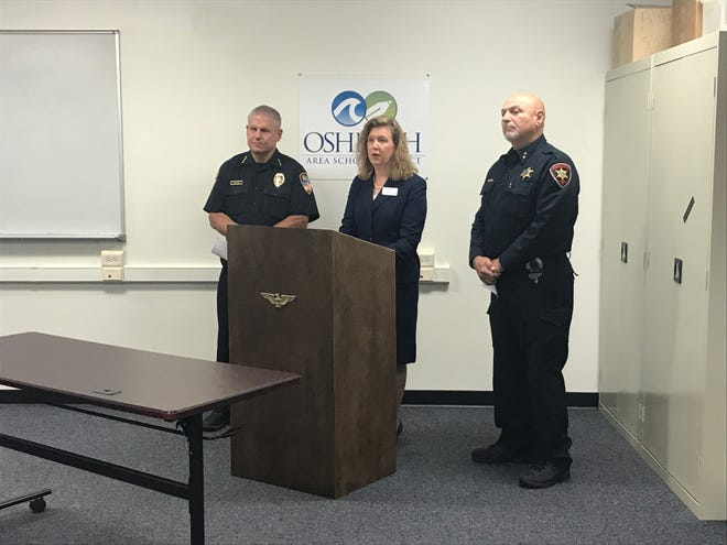 Oshkosh Police Chief Dean Smith, from left, Oshkosh Area School Superintendent Vickie Cartwright and Winnebago County Sheriff John Matz host a news conference Wednesday, Sept. 25, 2019, about school safety threats.