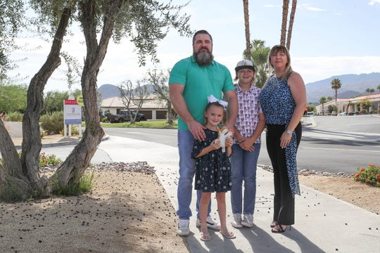 Brian and Judy Hathaway and their children MaryJane and Zane live in the house in the background and would be the closest residents to a proposed In-N-Out on Magnesia Falls and Highway 111 in Rancho Mirage, Calif., September 25, 2019.