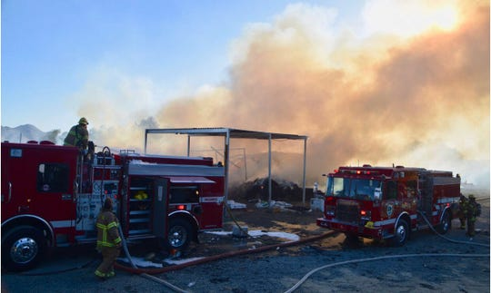 Firefighters are at the scene of a Moreno Valley hay bale fire on Theodore Street on Tuesday, Sept. 24. Ten goats died and four cows were injured.