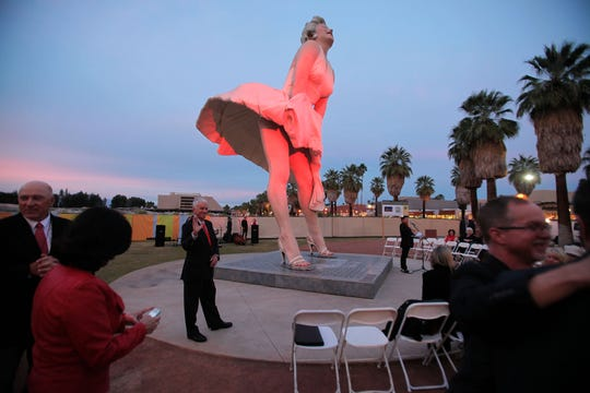 "Red lights flood the ""Forever Marilyn"" statue in downtown Palm Springs January 2014."