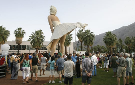 """Hundreds of people gather around   """"Forever Marilyn,"""" the 26 foot tall sculpture of  the Hollywood icon Marilyn Monroe, after the formal unveiling in downtown Palm Springs on Thursday, May 24, 2012."""