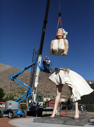 """The """"Forever Marilyn"""" statue gets assembled by workers from The Sculpture Foundation on Tuesday, May 15, 2012, in Palm Springs."""