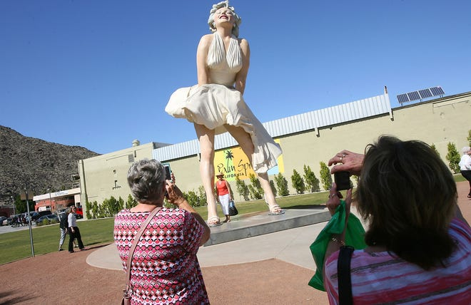 """Tourists take photographs of the """"Forever Marilyn"""" statue in downtown Palm Springs in February 2013."""