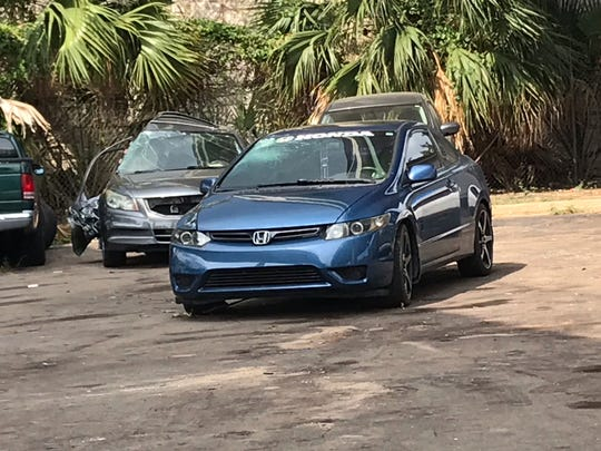 A blue Honda Civic that Pensacola police say was involved in a hit-and-run crash Saturday is parked Wednesday at the Pensacola Police Department.