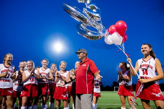 Bermudian Springs field hockey head coach Neil Bixler reacts as the team surprises him after his 300th career coaching win on Tuesday, Sept. 24, 2019. The Eagles defeated Gettysburg, 6-0.