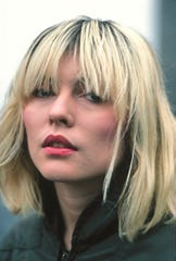 """I was playing up the idea of being a very feminine woman while fronting a male rock band in a highly macho game,"" Debbie Harry writes in ""Face It."""
