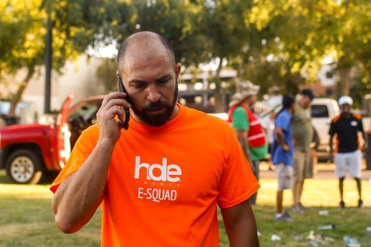 Landon Evans, owner of special events coordinator HDE Agency, takes a call while helping set up for the Rockin' Taco Street Festival Friday, September 13, 2019 in Chandler.