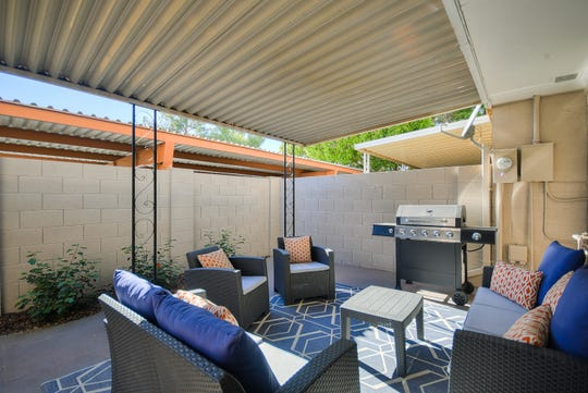 The patio turned into a secluded hideout when a tall block wall replaced the chain link fence.