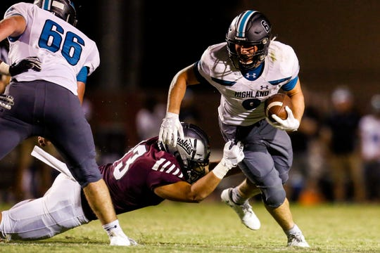 Gilbert Highland's Daniel Wood (6) narrowly avoids a tackle in the fourth quarter of a game at a Chandler Hamilton on Aug. 30.