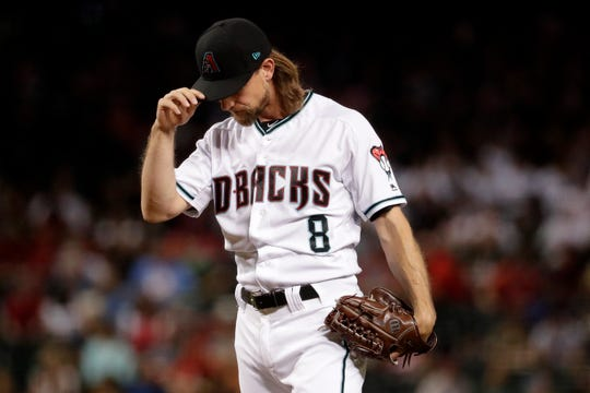 Arizona Diamondbacks starting pitcher Mike Leake adjusts his cap after giving up a home run against the St. Louis Cardinals during the first inning of a baseball game, Tuesday, Sept. 24, 2019, in Phoenix.