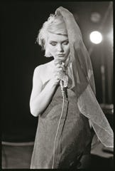 Debbie Harry says becoming a more extroverted version of herself on stage took practice.