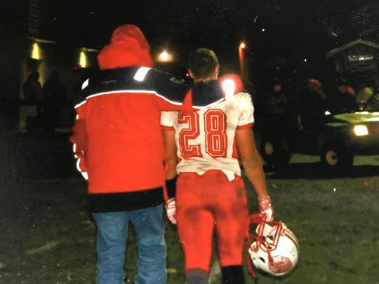 Todd Finke consoles his grandson, Emerson Lowe, after Port Clinton's postseason setback to Bishop Hartley in 2015.