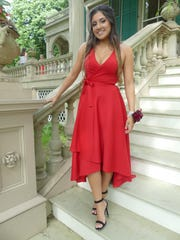 Jacqueline Rodriguez poses for a photo at her senior prom.