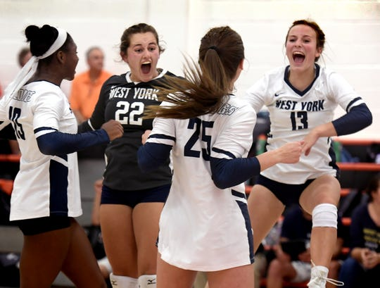 West York players Kambrie Hepler (22) and Matie Rupp (13) celebrate a point with teammates Tesia Thomas, left, and MJ Rupp against York Suburban during volleyball action at Suburban Tuesday, Sept. 24, 2019. Bill Kalina photo