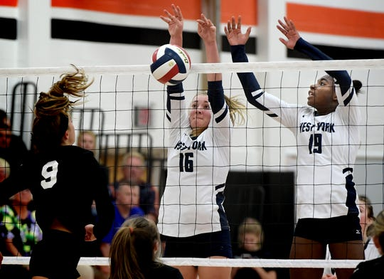 West York's Georgianna Kahley (16) and Tesia Thomas deny a shot by York Suburban's Eliana Rodgers pushes a shot with West York's Tesia Thomas defending during volleyball action at Suburban Tuesday, Sept. 24, 2019. Bill Kalina photo
