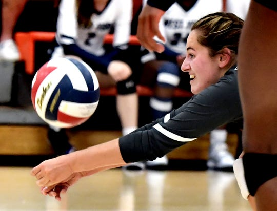 West York's Kambrie Hepler dives for a serve against York Suburban during volleyball action at Suburban Tuesday, Sept. 24, 2019. Bill Kalina photo