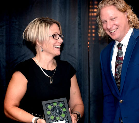 I.D.E.A.S Center Director Melissa Plotkin laughs with York County Economic Alliance president and CEO Kevin Schreiber during the Spirit of YoCo Awards at Wyndham Garden York Wednesday, Sept. 25, 2019. The ceremony, sponsored by the YCEA, recognized community-impact leaders in the county. Plotkin's group was awarded the Diversity Impact Award. Bill Kalina photo