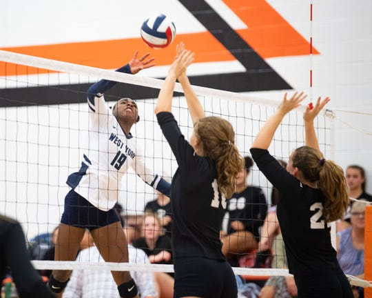 Tesia Thomas (19) looks to score during the YAIAA volleyball game between York Suburban and West York at York Suburban Senior High School, Tuesday September 24, 2019. The Bulldogs defeated the Trojans 3-2.