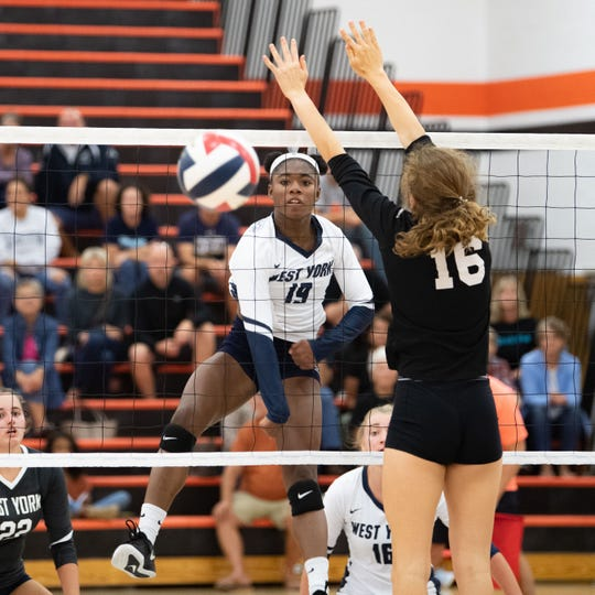 Tesia Thomas (19) spikes the ball past the defense during the YAIAA volleyball game between York Suburban and West York at York Suburban Senior High School, Tuesday September 24, 2019. The Bulldogs defeated the Trojans 3-2.