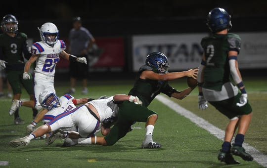 Damonte Ranch's Ethan Kulpin (7) reaches for a touchdown while taking on Reno during their football game at Damonte on Sept. 13, 2019.