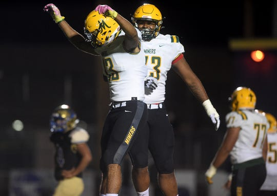 Bishop Manogue's Curtis Luckadoo (13) celebrates a touchdown with teammate Joseph Wright (73) while taking on Reed during their football game in Sparks on Sept. 20, 2019.
