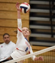 Reno's Carrie Crom goes up to spike the ball against Damonte Ranch at Reno High School on Sept. 10, 2019.