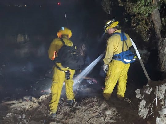 Reno firefighters extinguish a fire near the Truckee River on Tuesday, Sept 24.