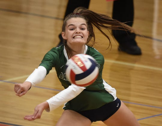 Damonte's Anjelica Myers reach for a Reno spike at Reno High School on Sept. 10, 2019.