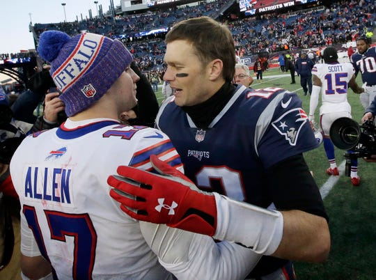 Buffalo Bills quarterback Josh Allen, left, and New England Patriots quarterback Tom Brady embrace after the Patriots 24-12 victory last December at Gillette Stadium. Both QBs struggled, with New England's 273 yards rushing making the difference.