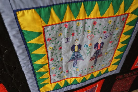 This story cloth was made by MaiChue Her and given to Pauline Mather as a gift. Her's family was sponsored by Mather's church to come to Salem after fleeing Laos and spending time in a Thailand refugee camp.