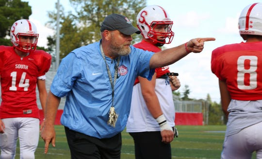 South Salem High School head football coach Scott DuFault works with his team during their practice at South Salem High School, September 24, 2019,  as they prepare for their game agains Sprague High School in Salem.
