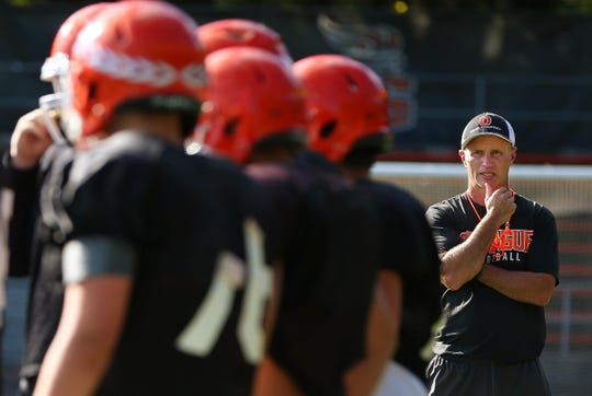 Sprague High School football head coach Jay Minyard watches as his team practices at Sprague High School, September 24, 2019,  as they prepare for their game agains South Salem High School in Salem.