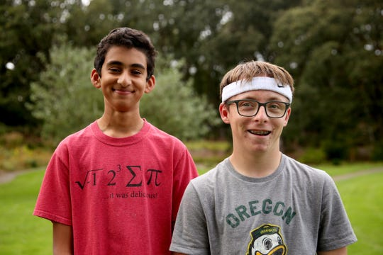 Mihir Joshi, left, a freshman, and Jackson Campbell, a junior, stand for a photo during a South Salem High School cross country practice at Bush's Pasture Park in Salem on Sep. 23, 2019. Jackson, who has a cognitive disability, completed his first cross country race after Mihir ran alongside him during a recent meet, encouraging him to finish.