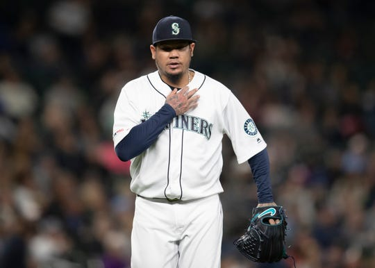 Seattle Mariners starting pitcher Felix Hernandez walks off the field during the fifth inning of the team's baseball game against the Chicago White Sox, Saturday, Sept. 14, 2019, in Seattle. The Mariners won 2-1 in 10 innings.