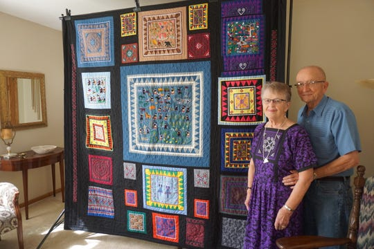 Pauline and Richard Mather of West Salem will deliver this quilt made of Hmong textile art to MaiChue Her, who grew up in Salem after her family fled Laos. Westminster Presbyterian Church, where the Mathers attend, sponsored the family to come to the U.S.