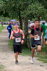 Jackson Campbell, left, and Mihir Joshi run together at the Saxon Invite cross country meet at Bush's Pasture Park in Salem on Sep. 7, 2019.