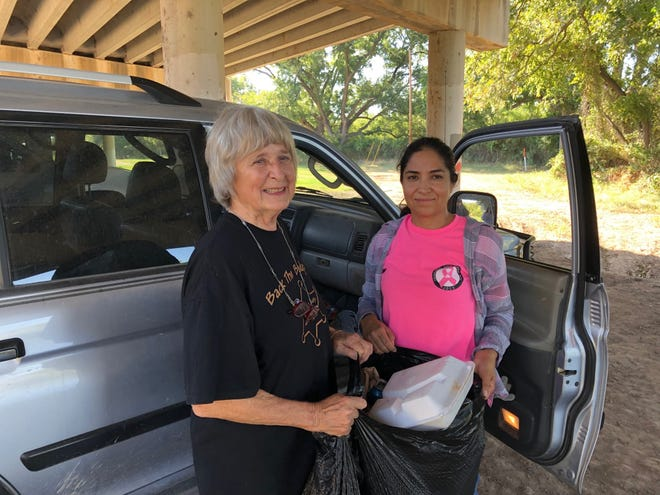Gail Stefanski and Carmen Torres cleaning up under San Angelo bridges.