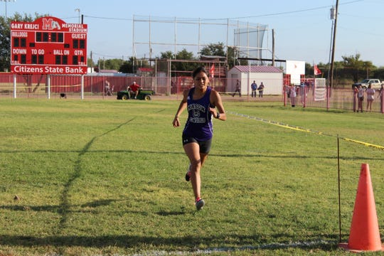 Mason's Ana Segura pushes toward the finish line at the Bob Fuller Cross Country Meet in Miles on Wednesday, Sept. 25, 2019. Segura won the two-mile race in 13 minutes.