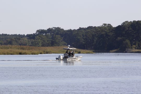 Officers with the Maryland Department of Natural Resources Police search the Wicomico River for a possible missing person on Wednesday, Sept. 25.
