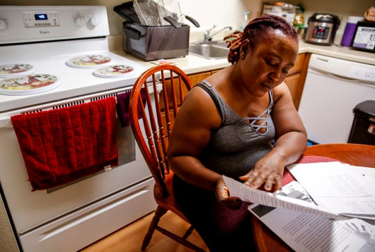 Francia Weay looks over a worksheet she did during the adult literacy course on Wednesday, Sept. 25, 2019. Weay, originally from Liberia, believes the course has helped broaden her understanding of different dialects.