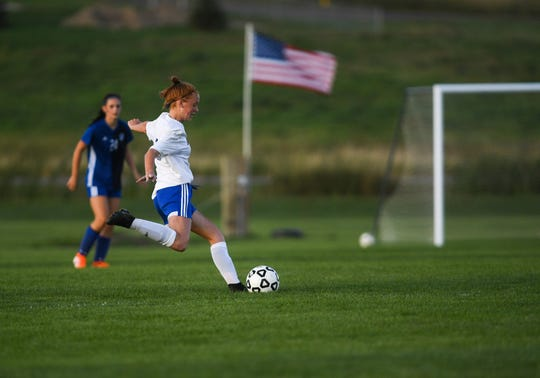 Sioux Falls Christian midfielder Ava Schock (8) kicks the ball toward the goal during the game at West Central on Tuesday, Sept. 24, 2019.