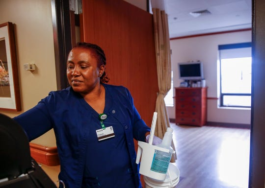 Francia Weay works as a housekeeper at Avera Health on Wednesday, Sept. 25, 2019. Weay is taking an adult literacy course through a partnership between Avera Health and REACH Literacy that has helped improve all aspects of her life.