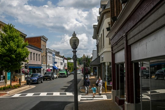 Shops in Front Royal, Va. Warren County officials and the county economic development authority promised residents a data center and retail complex that would bring 600 jobs, but they and others allegedly siphoned away millions of public funds instead for personal use.