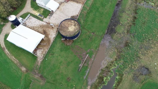 An aerial view shows a liquid manure spill near Holdingford. An estimated 20,000 gallons leaked into the low land area.