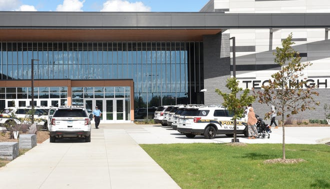 Squad cars are lined up outside of Tech High School Wednesday, Sept. 25, 2019.