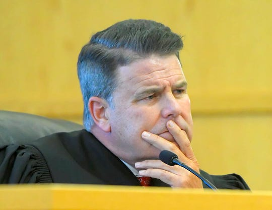 """Judge Kevin Allen listens as Prosecuting Attorney James Swink speaks at Alex Whipple's sentencing hearing on Tuesday, Sept. 24, 2019, in Logan, Utah. Whipple, of Utah who pleaded guilty to killing and sexually assaulting his 5-year-old niece, Elizabeth """"Lizzy"""" Shelley, was sentenced to life in prison with no chance of parole. (Eli Lucero/The Herald Journal via AP, Pool)"""